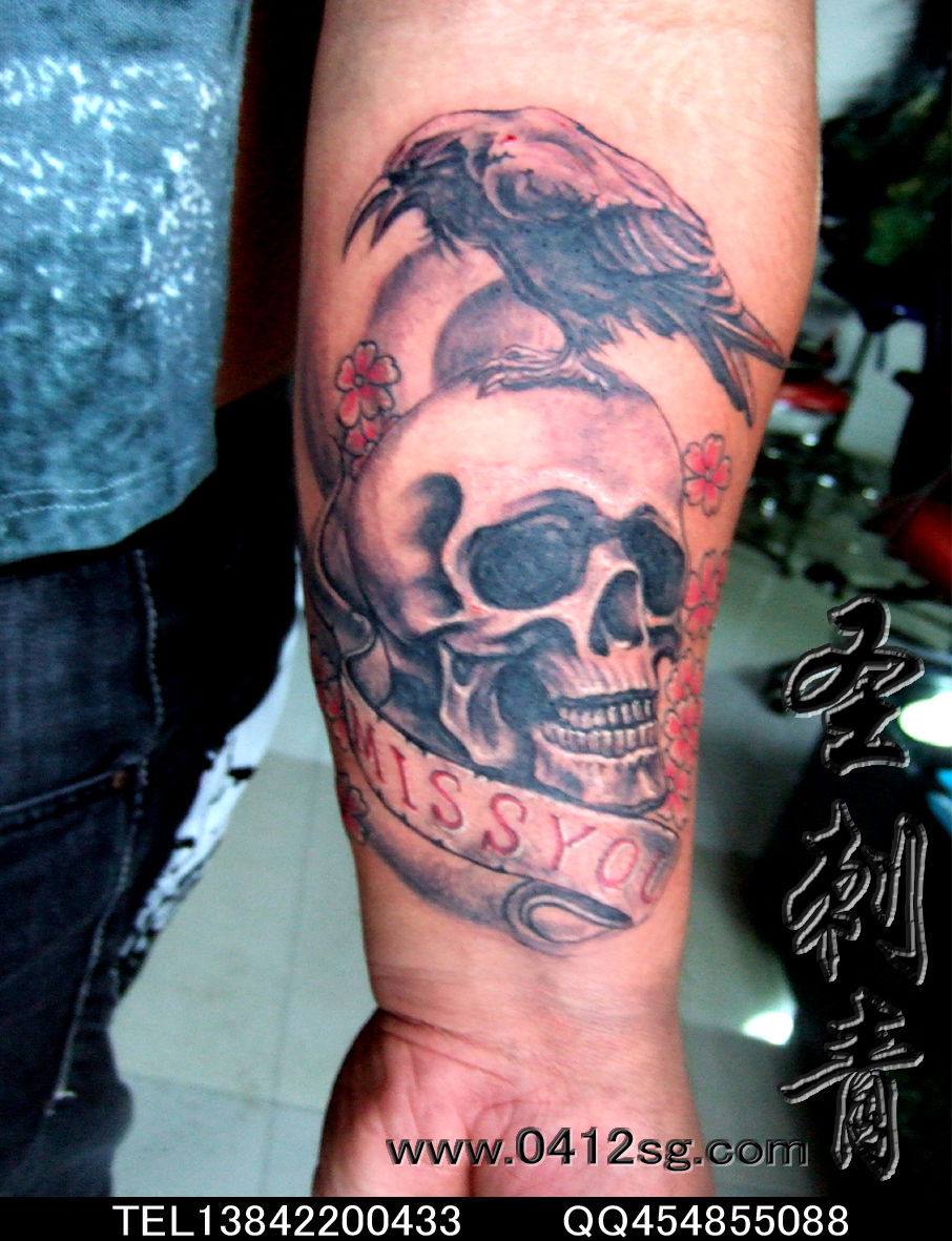 手臂上的小猫咪纹身图案图片