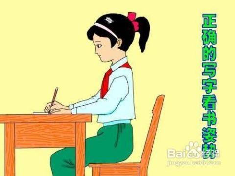 讓孩子以正確的姿勢坐在桌前讀書.圖片